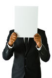 Business Man with White Card. Business man holding up a white card that can be filled in with any concept Royalty Free Stock Photo
