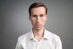 Business man in white shirt, portrait on grey background. Stock Photos