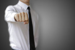 Business man in white shirt showing a fist.  Stock Photo