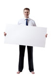 Business man whith empty board in hand. And shoeless Royalty Free Stock Images
