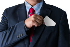 Business man who takes out business card from the pocket of busi Stock Photos