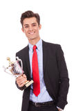 Business man winner holding a cup trophy Royalty Free Stock Photography