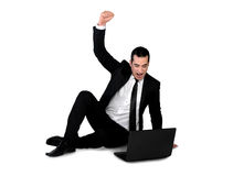 Business man winner with laptop. Isolated business man winner with laptop Stock Images