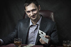 Business man winner playing poker Stock Photography