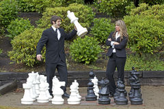 Business man winning at chess Royalty Free Stock Images