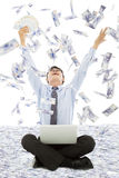 Business man winning a lottery with money rain Royalty Free Stock Photos