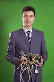 Business man with wires in his hands Royalty Free Stock Photos
