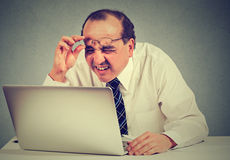 Free Business Man With Glasses Having Eyesight Problems Confused With Laptop Software Royalty Free Stock Images - 71795179