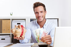 Business Man With Piggy Bank Stock Images