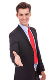 Business man wlecoming you with a handshake Stock Images