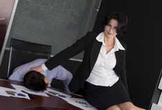 Business man and woman. Business workgroup interacting in a boardroom setting Stock Photos