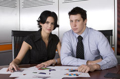 Business man and woman. Business workgroup interacting in a boardroom setting Royalty Free Stock Photography