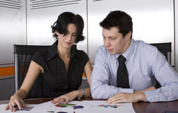 Business man and woman. Business workgroup interacting in a boardroom setting Stock Photography