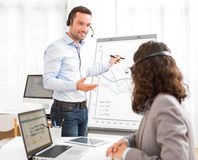 Business man and woman analysing stats while doing video confere Stock Photo