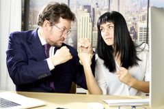 Business man and woman angry at each other in office Royalty Free Stock Photo