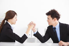 Business man and woman arm wrestling Royalty Free Stock Image