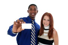 Business Man and Woman with Business Card Stock Images