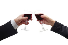 Business man and woman celebrate with red wine Royalty Free Stock Photos
