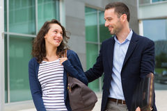 Business man and woman chatting together after work Royalty Free Stock Photography