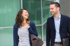 Business man and woman chatting together after work Royalty Free Stock Images