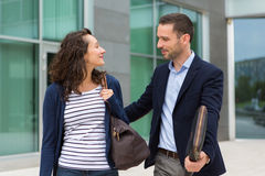Business man and woman chatting together after work Royalty Free Stock Photo