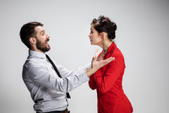The business man and woman communicating on a gray background Royalty Free Stock Images