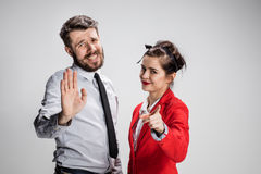 The business man and woman communicating on a gray background Stock Images