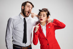 The business man and woman communicating on a gray background Stock Image