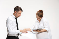 The business man and woman communicating on a gray background Stock Photo