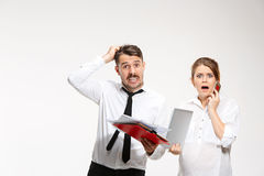 The business man and woman communicating on a gray background Royalty Free Stock Photography