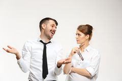 The business man and woman communicating on a gray background Stock Photography