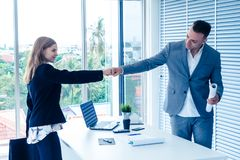 Business man and woman business couple fist bump hand together f royalty free stock image