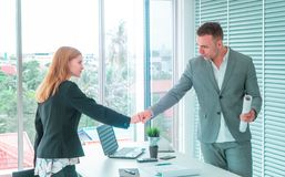 Business man and woman couple fist bump hand together f royalty free stock image