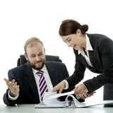 Business man and woman at desk royalty free stock photo