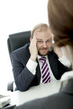 Business man and woman at desk has headache Stock Photography