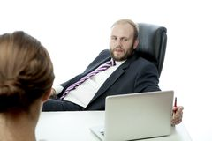 Business man and woman at desk ignore. Beard business men brunette women at desk ignoring Royalty Free Stock Image