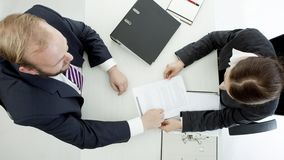 Business man and woman at desk working view above Royalty Free Stock Photography
