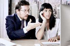 Business man and woman desperate about stock market going down stock image