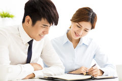 Business man and woman discussing document in office Stock Images