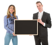 Business man and woman with empty chalkboard Royalty Free Stock Photo