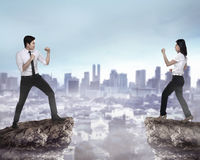 Business man and woman fighting Stock Images