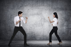 Business man and woman fighting Royalty Free Stock Photography