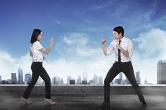 Business man and woman fighting Stock Image