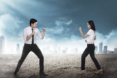 Business man and woman fighting Royalty Free Stock Images