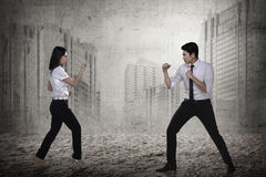 Business man and woman fighting Royalty Free Stock Photo