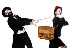Business man and woman fighting over briefcase Royalty Free Stock Photos