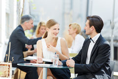 Business man and woman flirting Stock Photo