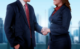 Business man and woman get deal with shaking hand Royalty Free Stock Photography