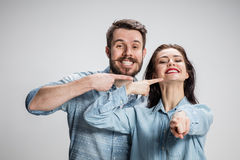 The business man and woman on a gray background Royalty Free Stock Photo
