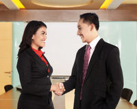 Business man and woman hand shake Stock Photography